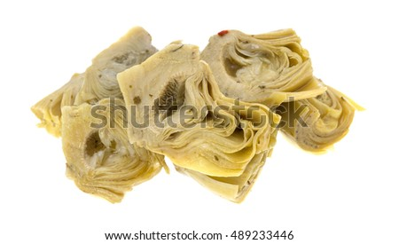 A portion of marinated artichoke hearts isolated on a white background.