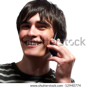 A portrait about a trendy attractive young man who is smiling and he is speaking with somebody by mobile phone. He is wearing a striped t-shirt. - stock photo