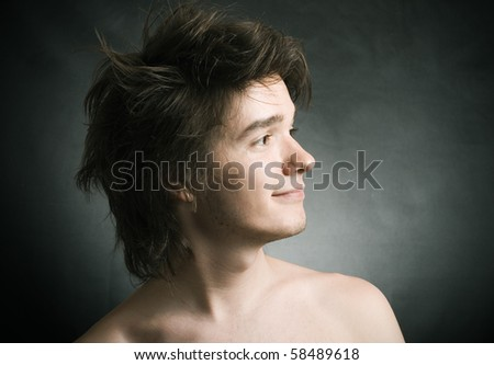 A portrait about a trendy cute guy who is smiling and he has an attractive look. - stock photo