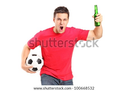 A portrait an euphoric fan holding a beer bottle and football cheering isolated on white background - stock photo