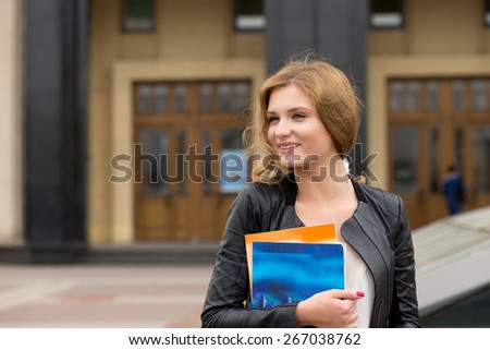 A portrait  college student on campus - stock photo