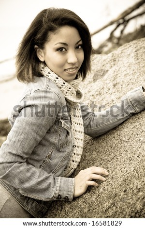 A portrait of a beautiful african american woman at the beach in sepia tone