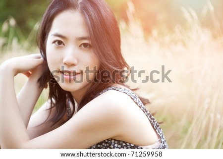 A portrait of a beautiful asian woman outdoor - stock photo
