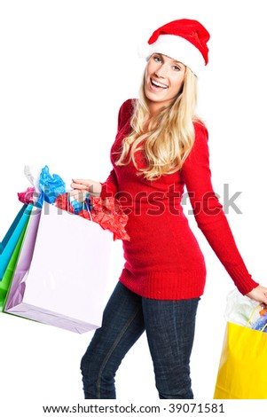 A portrait of a beautiful caucasian christmas santa girl carrying shopping bags - stock photo