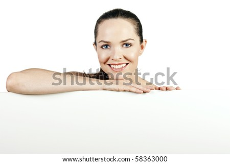A portrait of a beautiful natural young woman smiling and looking at camera. - stock photo