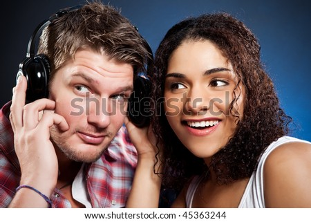 A portrait of a beautiful romantic interracial couple in love - stock photo