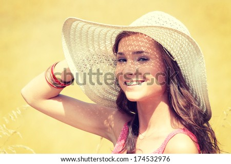 A portrait of a beautiful woman on farmland - stock photo