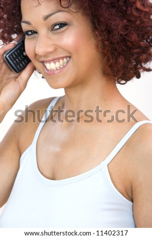 A portrait of a beautiful young woman talking on her cellphone