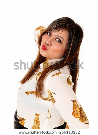 A portrait of a beautiful young woman with brunette hair, her mouth ready for a kiss, isolated for white background.  - stock photo