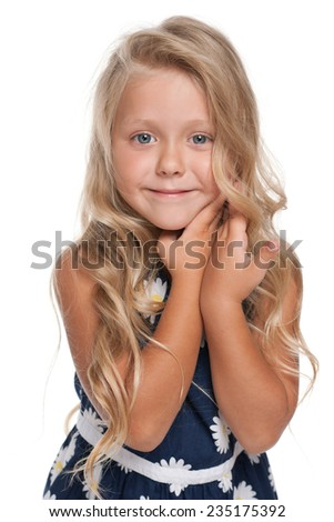A portrait of a blonde little girl on the white background - stock photo
