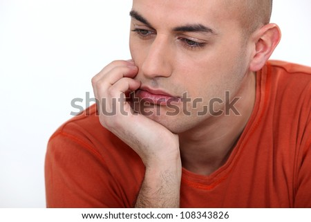 A portrait of a bored man. - stock photo