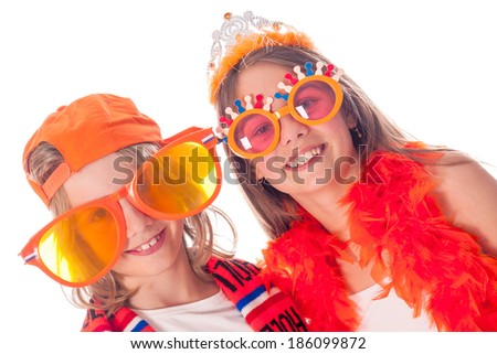 a portrait of a boy and a girl, the supporters of the dutch soccer team,on a white background - stock photo