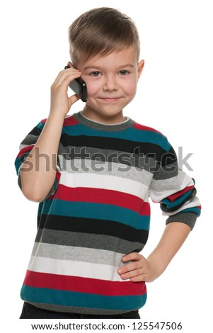 A portrait of a cheerful boy with a cell phone; isolated on the white background - stock photo
