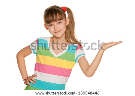 A portrait of a cheerful girl in a striped blouse makes a hand gesture - stock photo