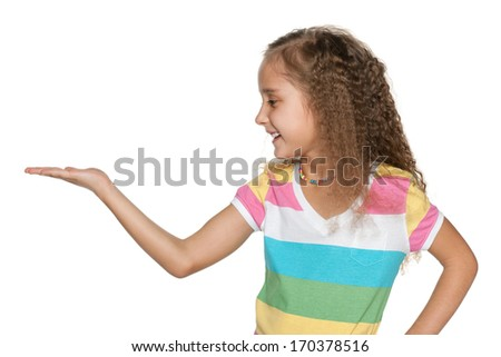 A portrait of a cheerful girl in a striped shirt makes a hand gesture - stock photo