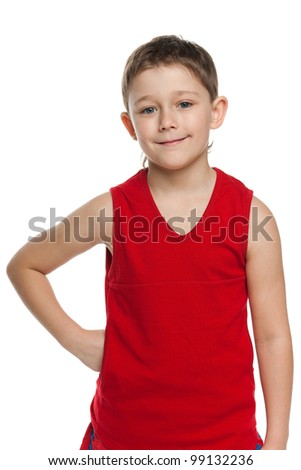 A portrait of a cheerful little boy in sportswear; isolated on the white background