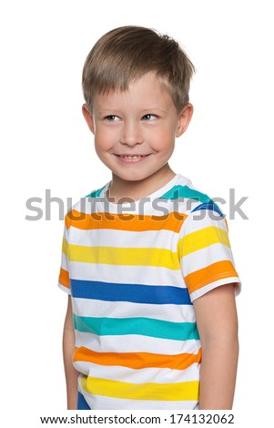 A portrait of a cheerful young boy in striped shirt on the white background - stock photo