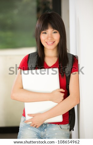 A portrait of a Chinese college student at her University campus - stock photo