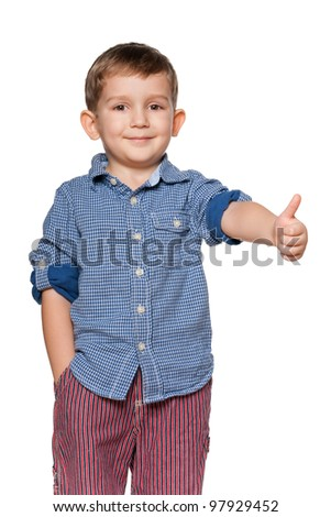 A portrait of a confident little boy holding his thumb up; isolated on the white background - stock photo