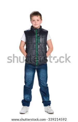 A portrait of a confident young boy in a jacket against the white background