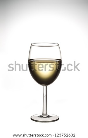 A portrait of a crystal glass with white wine isolated - stock photo