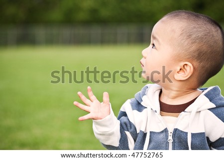 A portrait of a cute asian boy - stock photo