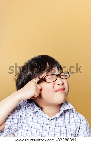 A portrait of a cute asian boy making a funny face - stock photo