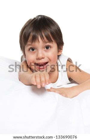 A portrait of a cute little boy on the white