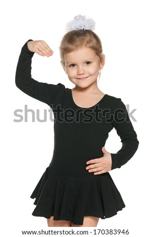 A portrait of a dancing little girl on the white background