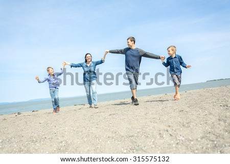 A Portrait of a Family having fun at the beach