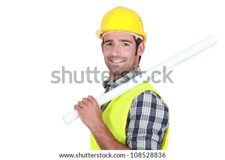 A portrait of a foreman with rolled plans.