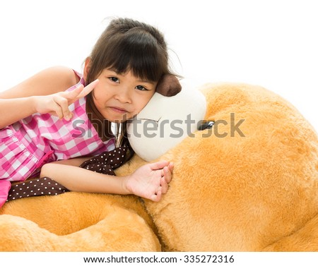 A portrait of a girl happiness and teddy on the white background