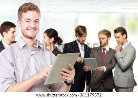 A portrait of a Group of mix-raced young businessperson and his team at the background - stock photo