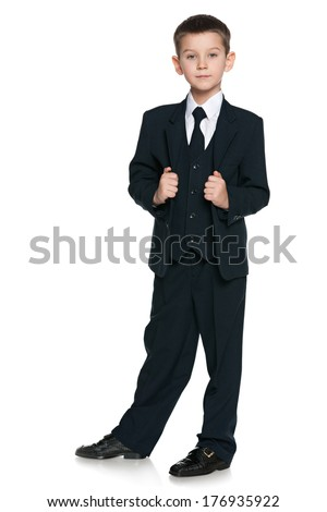 A portrait of a handsome boy in the black suit on the white background - stock photo