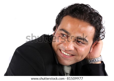 A portrait of a handsome Indian guy in a happy mood, on white studio background. - stock photo