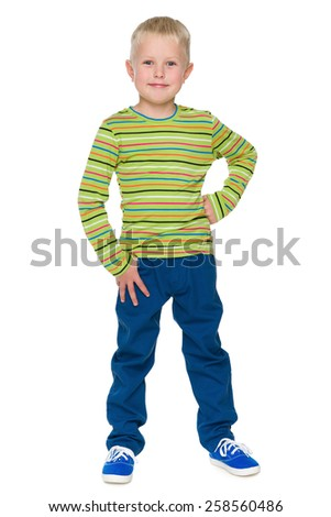 A portrait of a handsome little boy in the blue pants