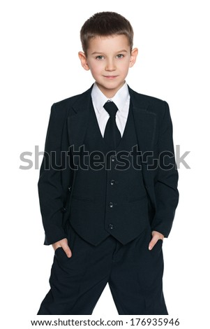 A portrait of a handsome young boy in the black suit on the white background - stock photo