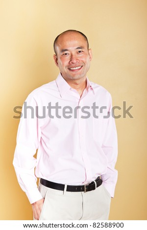 A portrait of a happy Asian businessman