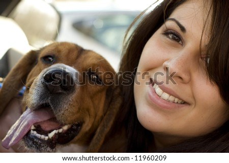 A portrait of a happy girl and her dog. - stock photo