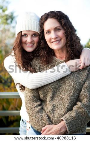 A portrait of a happy mother and daughter outdoor