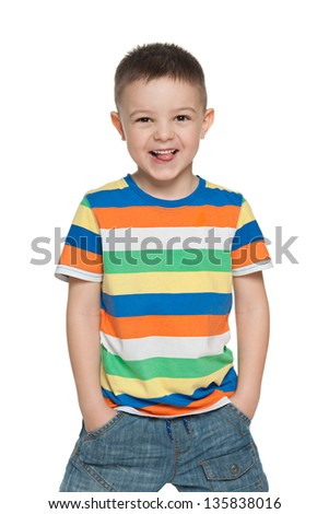 A portrait of a happy preschool boy; isolated on the white background - stock photo