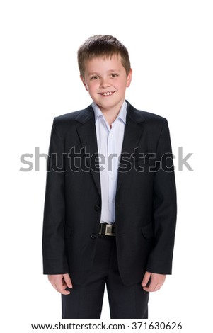 A portrait of a happy schoolboy in the suit on the white background - stock photo