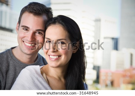 A portrait of a happy smiling couple - stock photo