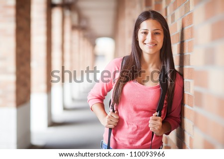 A portrait of a hispanic college student at campus - stock photo
