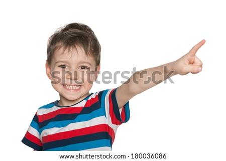A portrait of a laughing boy pointing aside - stock photo