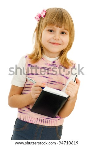 A portrait of a little girl with notebook; isolated on the white background - stock photo