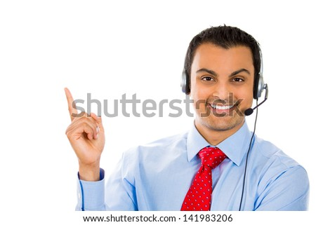 A portrait of a male customer support member pointing at a copy space  - stock photo