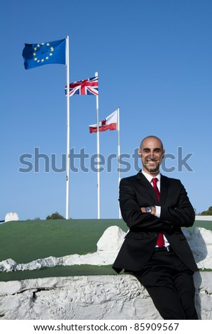 A portrait of a man under the flags of Gibraltar, Great Britain & Europe. - stock photo