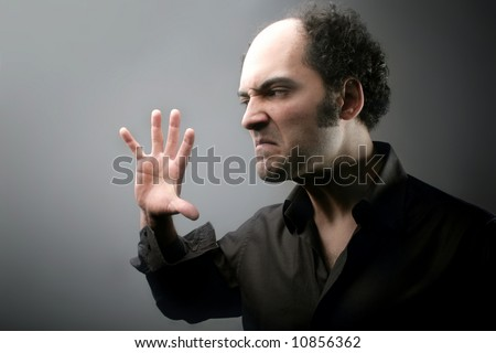 a portrait of a man with a anger expression - stock photo