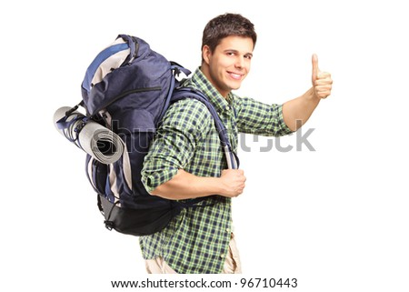 A portrait of a man with backpack giving thumb up isolated on white background - stock photo